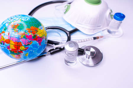 World health day, Stethoscope wrapped around globe on white background. Vaccine Covid 19, Coronavirus. Save the wold, Global health care and Green Earth day concept