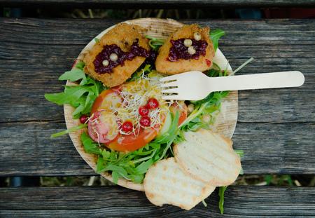 Roasted vegetable platter with fork. Organic Snack served on vintage Background.