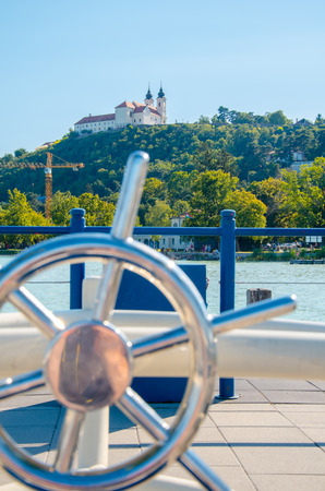 Tihany abbey with steering wheel, vacation sign, portrait view seen from harbour Stock Photo