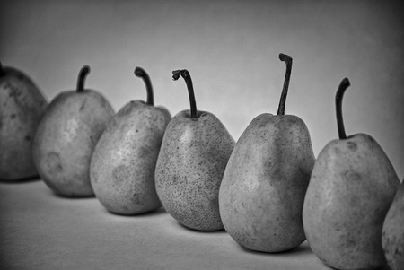 blackandwhite: ripe pears on a white background. black-and-white photo with filters