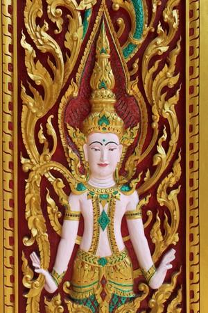 carving on the door of temple, Ban Dan, Burirum, North-East of Thailand photo