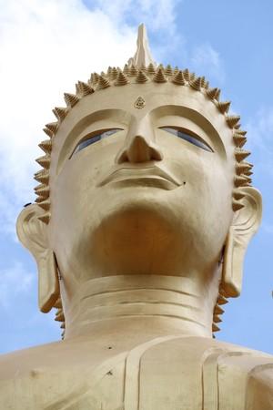 standing buddha image, Wat Burapaphiram, Roi-et photo