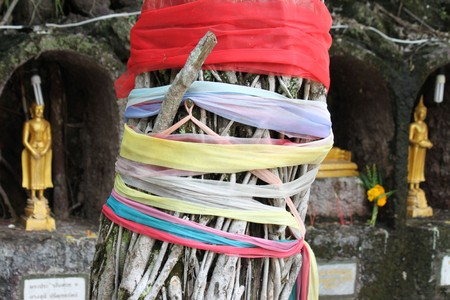 tie many color ribbons round a tree to explicit worship in buddha photo