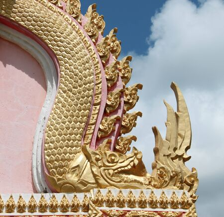 buddhist art on archway of temple photo