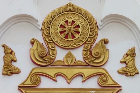 buddhist art on wall of temple photo