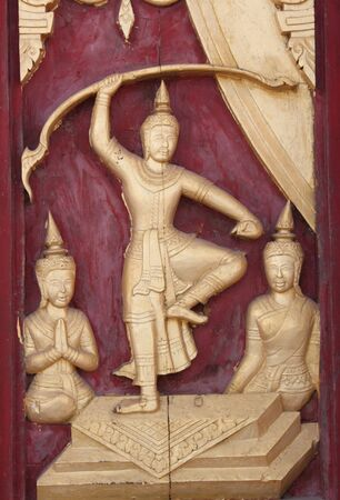 Thai art carving and painting on door of temple Stock Photo - 7755310