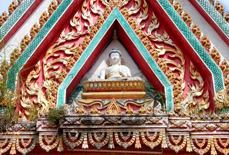 archway: buddha image on archway of buddhist temple