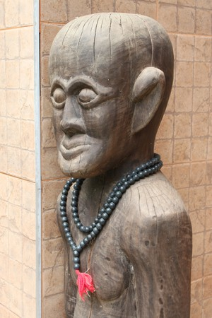 Picture of local Lao P.D.R. old man wood carving photo