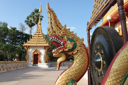 naga in front of buddhist temple photo