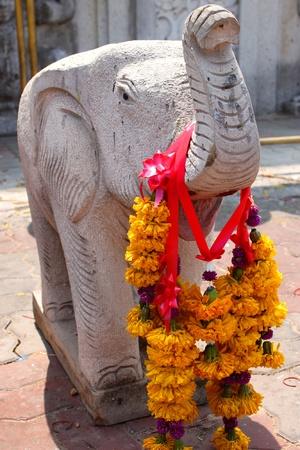 Elephant statue, Nadun pagoda, Mahasarakam photo