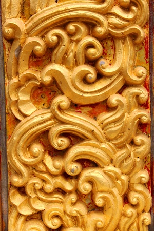 Traditional Thai style stucco texture on pillar of temple photo