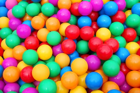 Pile of colorful little balls for children to play around photo