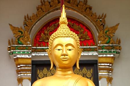 Buddha image in front of church, Wat Naga Wichai, Mahasarakam, Thailand Stock Photo - 10350979