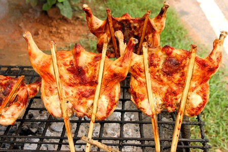 Grilled chicken over gridiron and low heat from natural charcoal Stock Photo - 10848414