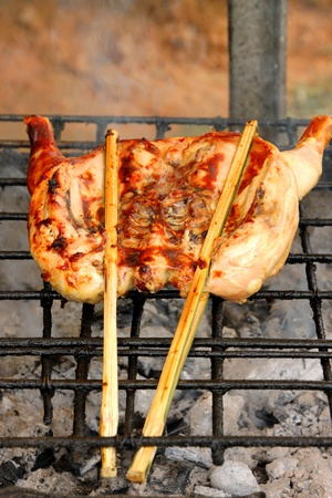 gridiron: Grilled chicken over gridiron and low heat from natural charcoal Stock Photo