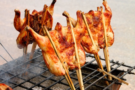 stab: Grilled chicken over gridiron and low heat from natural charcoal Stock Photo