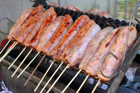 Grilled sausages over gridiron and low heat from natural charcoal photo