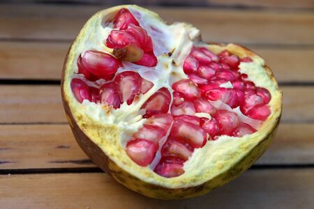 A picture of pomegranate splited in half fruit Stock Photo - 10884563