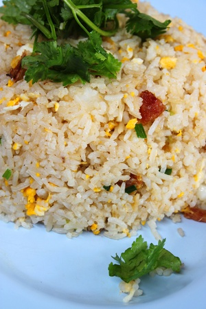 Fried rice with chicken egg topping with parsley and corainder   photo