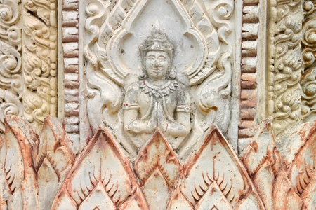 Buddhist art stucco on wall or pillar of Thai temple and sanctuary photo