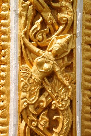 Buddhist art stucco on wall or pillar of Thai temple and sanctuary Stock Photo - 10884595