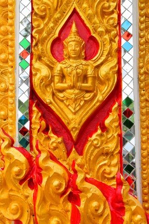 Buddhist art stucco on wall or pillar of Thai temple and sanctuary Stock Photo - 10884587