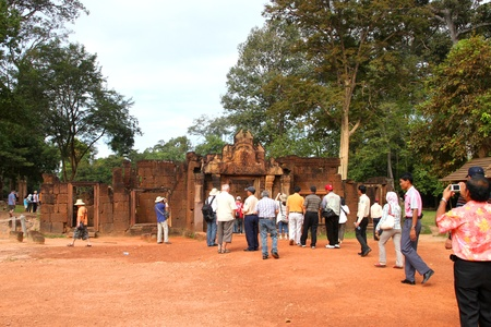 SIEMREAP, KHMER REPUBLIC - NOVEMBER 6 : The unidentified tourists are travel in group of Prasats or sanctuaries on November 6, 2011 at Banteay Srey, Siemreap, Khmer Republic.