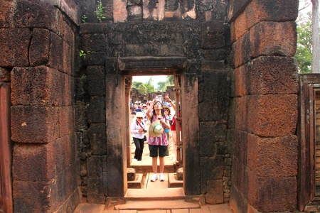 SIEMREAP, KHMER REPUBLIC - NOVEMBER 6 : The unidentified tourists are travel in group of Prasats or sanctuaries and take a photograph for commemoration on November 6, 2011 at Banteay Srey, Siemreap, Khmer Republic.