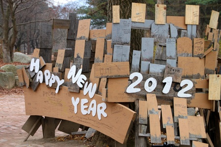 NAMINARA REPUBLIC, KOREA - NOVEMBER 26 : The happy new year 2012 wooden sign is locating for welcome the tourists on November 26, 2011 at Nami island, Naminara Republic, Korea.