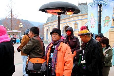 EVERLAND, YONGIN, KOREA - NOVEMBER 26 : The unidentified group of tourists are enjoy travelling and be happy on November 26, 2011 at Everland, Yongin, Korea.