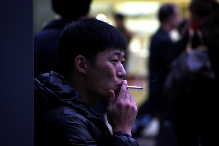 DONGDAEMUN, CENTRAL SEOUL, KOREA - NOVEMBER 27 : The unidentified tourist is smoking in smoke area of Dongdaemun market on November 27, 2011 at Central Seoul, Korea. Stock Photo - 11366497