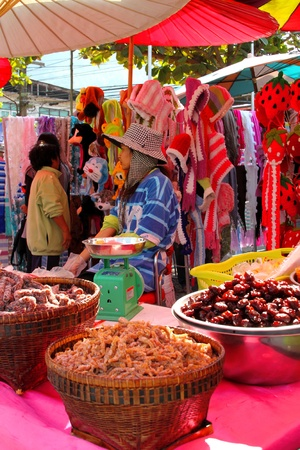 PHA NOK KHAO, LOEI, THAILAND - DECEMBER 12 : The unidentified woman is selling One Tambol One Product dessert on December 12, 2011 at Pha Nok Khao footpath market, Loei, Thailand. Stock Photo - 11459177