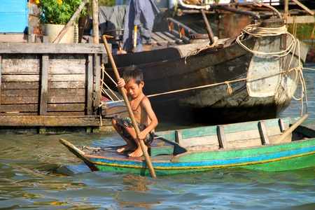 SIEMREAP, KHMER REPUBLIC - NOVEMBER 5 : The picture of way of life of Khmer child in the greatest freshwater lake in the world on November 5, 2011 at Tonle Sap Lake, Siemreap, Khmer Republic. Stock Photo - 11542774