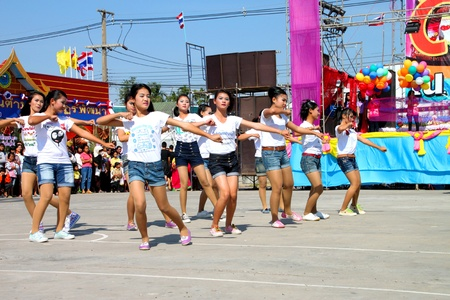 PAYAKKAPHUMPHISAI, MAHASARAKHAM - DECEMBER 17 : The unidentified Thai school children are performing their aerobic outdoor One Tambol One Product (OTOP) festival season on December 17, 2011 at district hall plaza, Payakkaphumphisai, Mahasarakham.