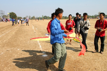 HUAI RAT, BURIRAM - DECEMBER 18 : The unidentified Thai men are preparing their kite to contest in kites festival season on December 18, 2011 at sport ground, Huai Rat, Buriram.