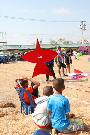 HUAI RAT, BURIRAM - DECEMBER 18 : The unidentified Thai man is preparing his kite to contest in kites festival season on December 18, 2011 at sport ground, Huai Rat, Buriram.