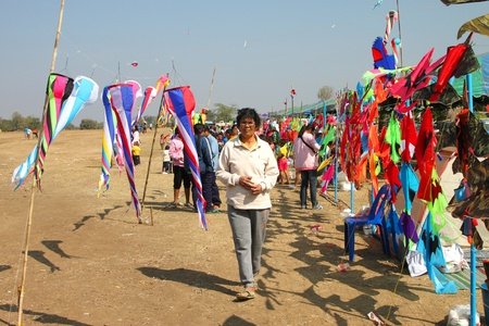 HUAI RAT, BURIRAM - DECEMBER 18 : The unidentified Thai woman is selecting to buy kites in kites festival season on December 18, 2011 at sport ground, Huai Rat, Buriram.