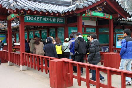 NAMINARA REPUBLIC, KOREA - NOVEMBER 26 : The unidentified tourists are waiting for tickets to travel to attraction places on November 26, 2011 at Nami island, Naminara Republic, Korea.