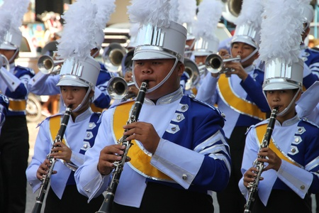 BORABUE, MAHASARAKHAM - DECEMBER 22 : The unidentified paraders are in local sports parade grand opening and festival season on DECEMBER 22, 2011 at sports ground, Borabue, Mahasarakham, Thailand.