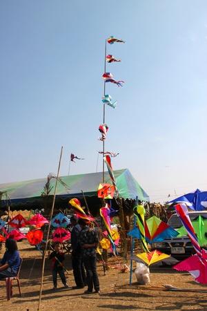 HUAI RAT, BURIRAM - DECEMBER 18 : The unidentified tourists are seeing kites show in northeast kites festival season on December 18, 2011 at sport ground, Huai Rat, Buriram.