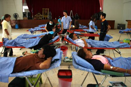 BORABUE, MAHASARAKHAM - JANUARY 6 : The unidentified sacrificers are in blood donation activities on January 6, 2012 at Borabue District Hall, Borabue, Mahasarakham, Thailand.