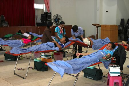 endow: BORABUE, MAHASARAKHAM - JANUARY 6 : The unidentified sacrificers are in blood donation activities on January 6, 2012 at Borabue District Hall, Borabue, Mahasarakham, Thailand. Editorial