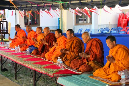 BORABUE, MAHASARAKHAM - JANUARY 6 : The unidentified monks are giving a sermon in Rice Celebration Festival on January 6, 2012 at Borabue Local Administration Plaza, Borabue, Mahasarakham, Thailand. Stock Photo - 11817632