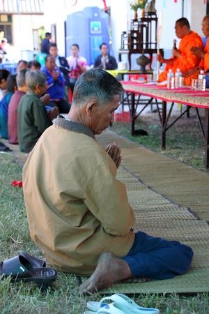 BORABUE, MAHASARAKHAM - JANUARY 6 : The unidentified buddhists are listening to a monks sermon in Rice Celebration Festival on January 6, 2012 at Borabue Local Administration Plaza, Borabue, Mahasarakham, Thailand. Stock Photo - 11817627