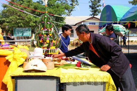 BORABUE, MAHASARAKHAM - JANUARY 6 : The unidentified buddhists are worshiping a spirit in Rice Celebration Festival on January 6, 2012 at Borabue Local Administration Plaza, Borabue, Mahasarakham, Thailand. Stock Photo - 11817636
