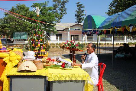 BORABUE, MAHASARAKHAM - JANUARY 6 : The unidentified buddhists are worshiping a spirit in Rice Celebration Festival on January 6, 2012 at Borabue Local Administration Plaza, Borabue, Mahasarakham, Thailand. Stock Photo - 11817638
