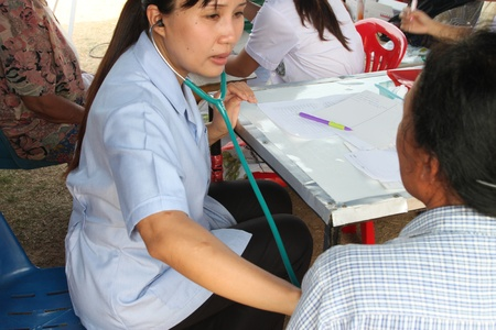 BORABUE, MAHASARAKHAM, THAILAND - JANUARY 19 : The unidentified nurse is auscultating a patient on January 19, 2012 at Wat Dong Keng, Borabue, Mahasarakham, Thailand.