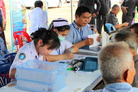 BORABUE, MAHASARAKHAM, THAILAND - JANUARY 19 : The unidentified nursing team is giving service to patients on January 19, 2012 at Wat Dong Keng, Borabue, Mahasarakham, Thailand.