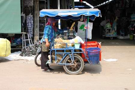 SAKAEO, THAILAND - FEBRUARY 3 : The unidentified Khmer woman is selling sugarcane juice, on February 3, 2012 at Rong Kluea Market, Sakaeo, Thailand.