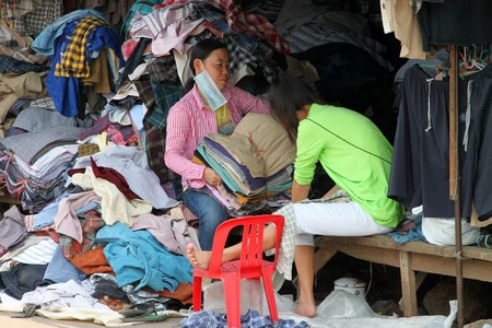 SAKAEO, THAILAND - FEBRUARY 3 : The unidentified Khmer women are selling second hand clothes on February 3, 2012 at Rong Kluea Market, Sakaeo, Thailand.